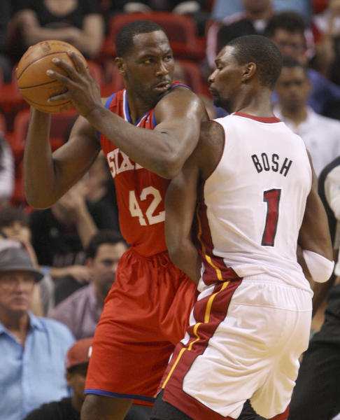 Philadelphia 76ers forward Elton Brand (42) looks for an open teammate past Miami Heat forward Chris Bosh (1) during the first half of an NBA basketball game, Tuesday, April 3, 2012 in Miami. (AP Photo/Wilfredo Lee)