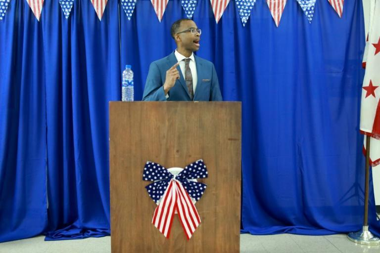 Joel Caston, pictured at his swearing in ceremony in the DC Jail in June 2021, rises before dawn every day to study, exercise, and phone his mom (AFP/-)