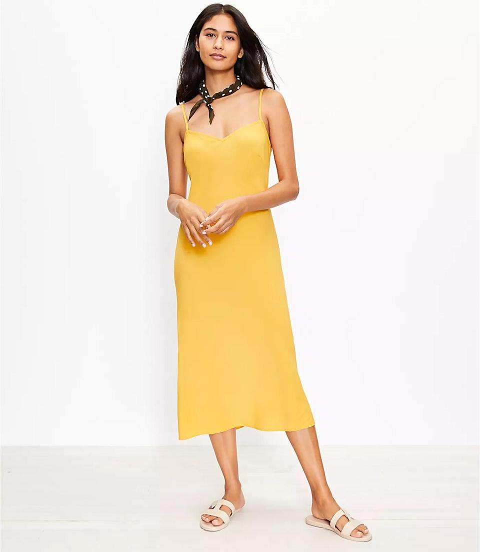 <p>You can easily dress up this <span>Loft Strappy Slip Dress</span> ($90, plus 30 percent off with code SOGOOD) with kitten heels or down with white sneakers for a day about town.</p>