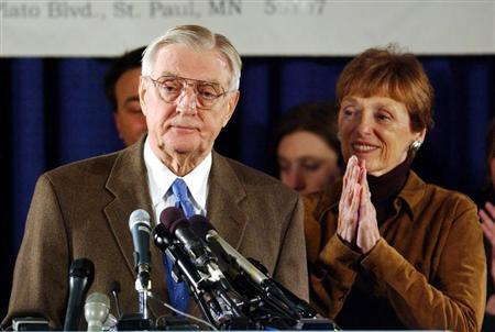 Democratic Senate candidate and former Vice President Walter Mondale stands at the podium with his w..