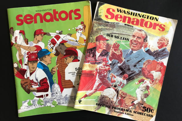 Washington Senators programs, including one featuring Richard Nixon and Ted Williams, right, are shown in New York, Tuesday, Oct. 15, 2019. Growing up in the Washington suburbs during the 1960s, the local baseball team was a lost cause. A trip to the World Series like these Nationals? Forget it. (AP Photo/Ben Walker)