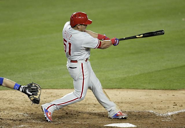 Philadelphia Phillies' Carlos Ruiz hits a two-run double during the ninth inning of a baseball game against the Los Angeles Dodgers on Thursday, April 24, 2014, in Los Angeles. (AP Photo/Jae C. Hong)