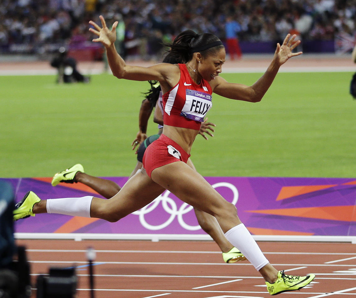 United States'  Allyson Felix crosses the finish line to win gold in the women's 200-meter final during the athletics in the Olympic Stadium at the 2012 Summer Olympics, London, Wednesday, Aug. 8, 2012. (AP Photo/Matt Slocum)