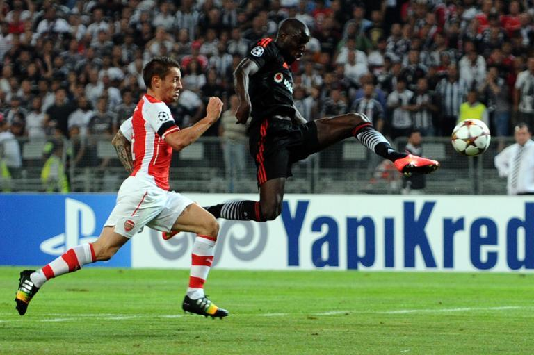 Besiktas' Demba Ba (R) vies with Arsenal's Laurent Kaschielny (L) during the UEFA Champions League play-off football match Besiktas vs Arsenal at Ataturk Olympic Stadium on August 19, 2014 in Istanbul