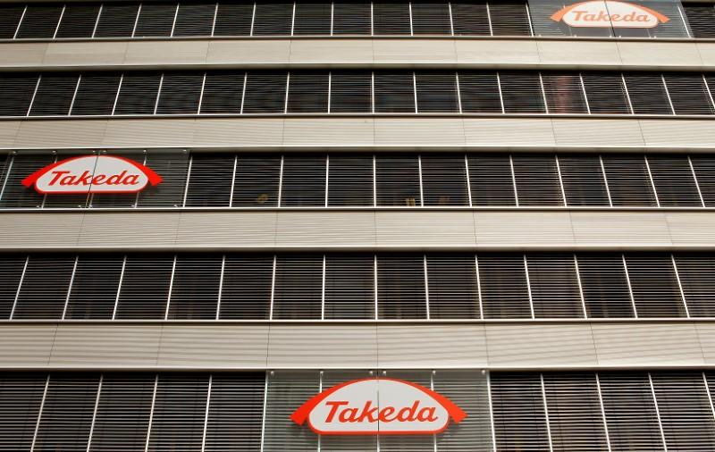 Logos of Japanese Takeda Pharmaceutical Co are seen at an office building in Glattbrugg