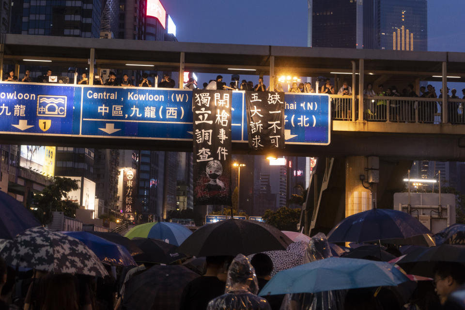 """People take part in a demonstration on August 18, 2019 in Hong Kong, China. Pro-democracy protesters have continued rallies on the streets of Hong Kong against a controversial extradition bill since 9 June as the city plunged into crisis after waves of demonstrations and several violent clashes. Hong Kong's Chief Executive Carrie Lam apologized for introducing the bill and declared it """"dead"""", however protesters have continued to draw large crowds with demands for Lam's resignation and complete withdrawal of the bill. (Photo by Delphia Ip/NurPhoto via Getty Images)"""
