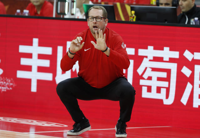 Canada coach Nick Nurse in his signature squatting pose. (REUTERS/Kim Kyung-Hoon)