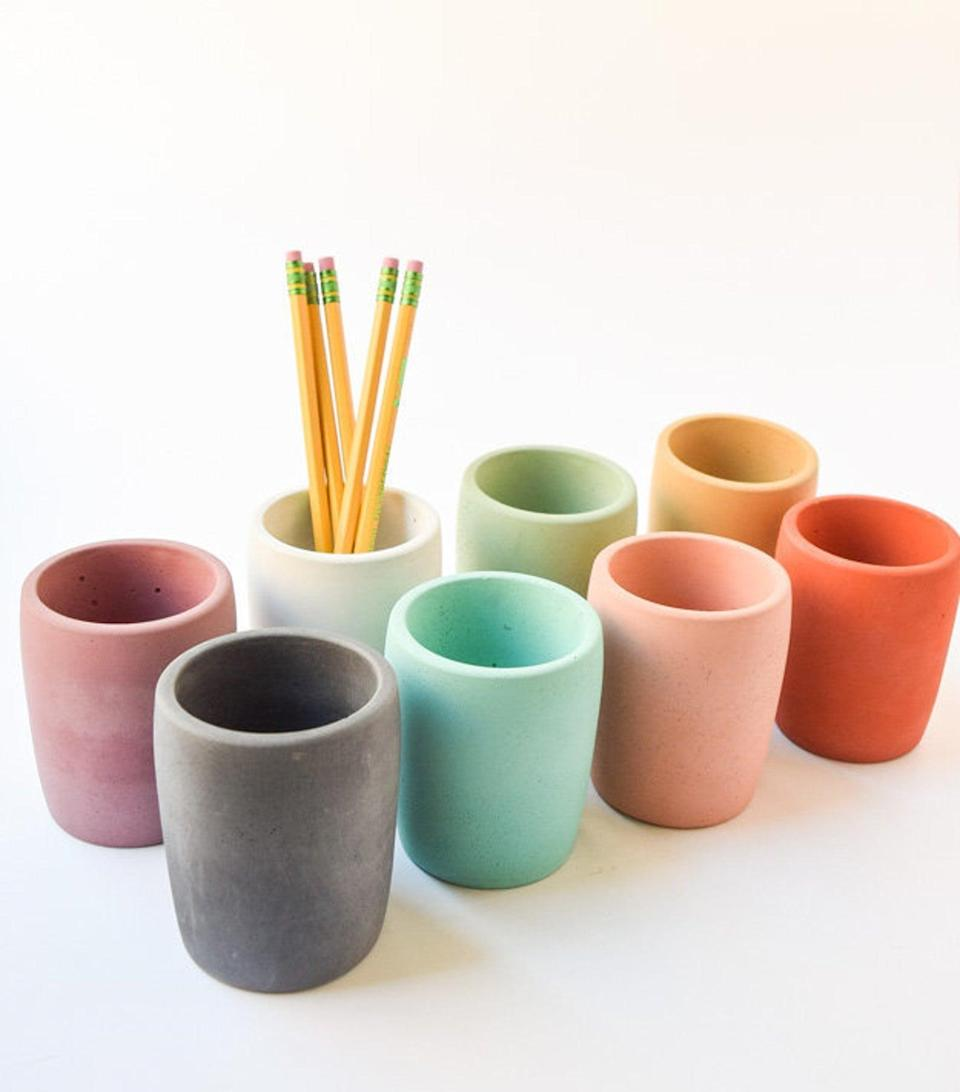 <p>These <span>Concrete Pencil Cups</span> ($14 each) are gorgeous.</p>
