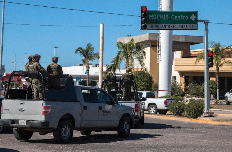 """Mexican Marines patrol the streets of Los Mochis, Sinaloa State in January 2016 after a military operation that resulted in drug lord Joaquin """"EL Chapo"""" Guzman's recapture (AFP Photo/Hector Guerrero)"""
