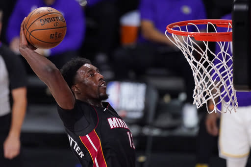 FILE - In this Oct. 11, 2020, file photo, Miami Heat's Bam Adebayo (13) dunks during the second half in Game 6 of basketball's NBA Finals against the Los Angeles Lakers in Lake Buena Vista, Fla. Adebayo and the Miami Heat are working on a contract extension, the team said Tuesday, Nov. 24, 2020, a deal that when finalized will likely guarantee him at least $168 million over the next six seasons and perhaps as much as $200 million in that span.(AP Photo/Mark J. Terrill, File)