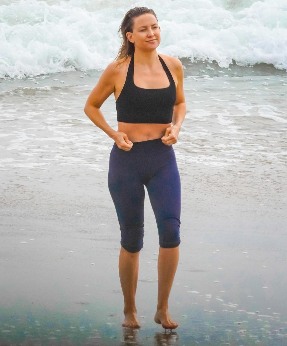 <p>Kate Hudson hits the beach in her workout gear during a day in Malibu on Thursday.</p>