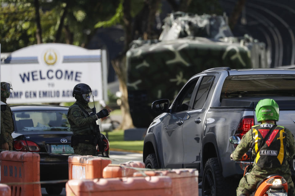 Soldiers secure the gates of Camp Aguinaldo military headquarters where U.S. Marine Lance Cpl. Joseph Scott Pemberton is held in Quezon city, Philippines, Thursday Sept. 3, 2020. A Philippine court has ordered the early release for good conduct for Pemberton who was convicted in the 2014 killing of transgender Filipino Jennifer Laude which sparked anger in the former American colony. (AP Photo/Aaron Favila)