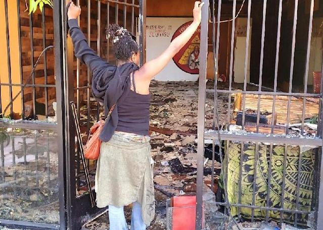 Zahalea Anderson looks at the burned-out remains of her business in Long Beach. (Courtesy of Zahalea Anderson)