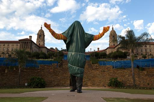 Still covered statue of South African former president Nelson Mandela is seen at the Union Buildings in Pretoria, on December 13, 2013