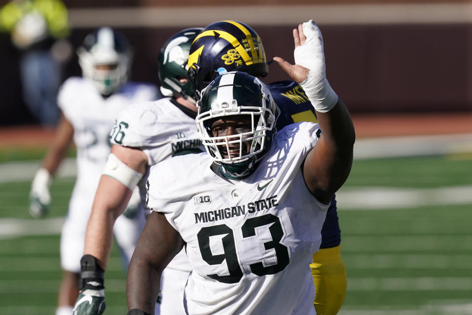 Michigan State defensive tackle Naquan Jones (93) reacts after sacking Michigan quarterback Joe Milton during the second half of an NCAA college football game, Saturday, Oct. 31, 2020, in Ann Arbor, Mich. (AP Photo/Carlos Osorio)