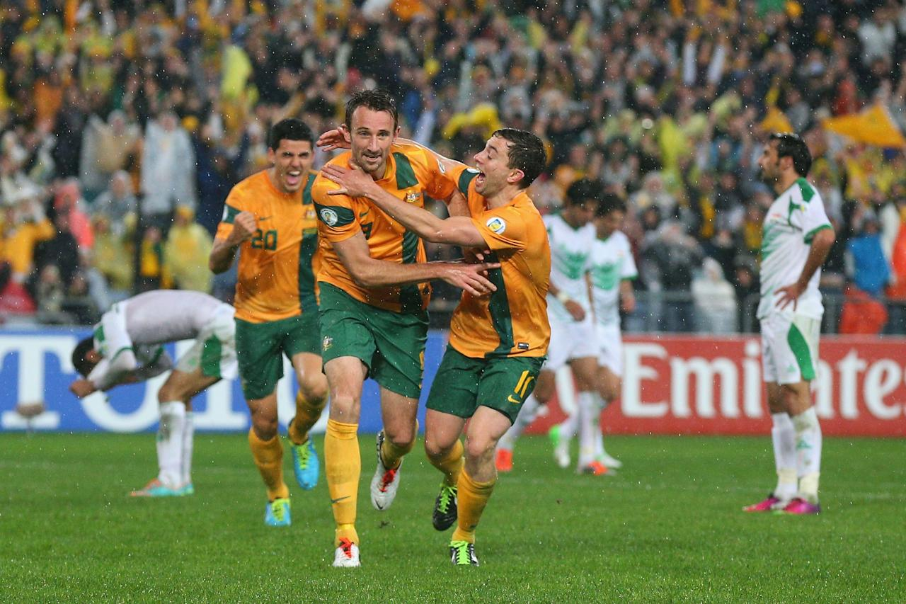SYDNEY, AUSTRALIA - JUNE 18: Josh Kennedy (L) of the Socceroos celebrates with team mate Tom Oar after heading the ball to score a goal during the FIFA 2014 World Cup Asian Qualifier match between the Australian Socceroos and Iraq at ANZ Stadium on June 18, 2013 in Sydney, Australia. (Photo by Cameron Spencer/Getty Images)