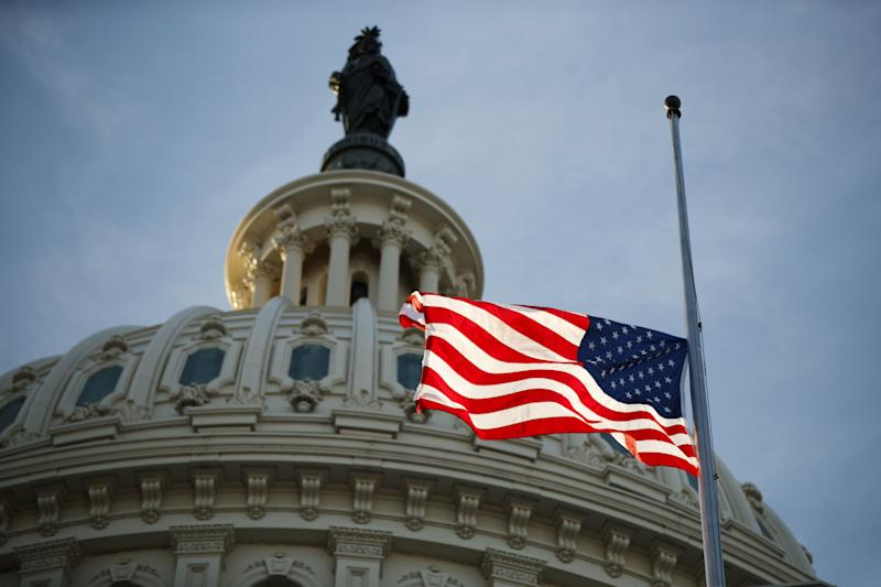 An American flag flies at half-staff at the U.S. Capitol in Washington on Monday, following the death of former President George H.W. Bush. (Photo: Bloomberg via Getty Images)