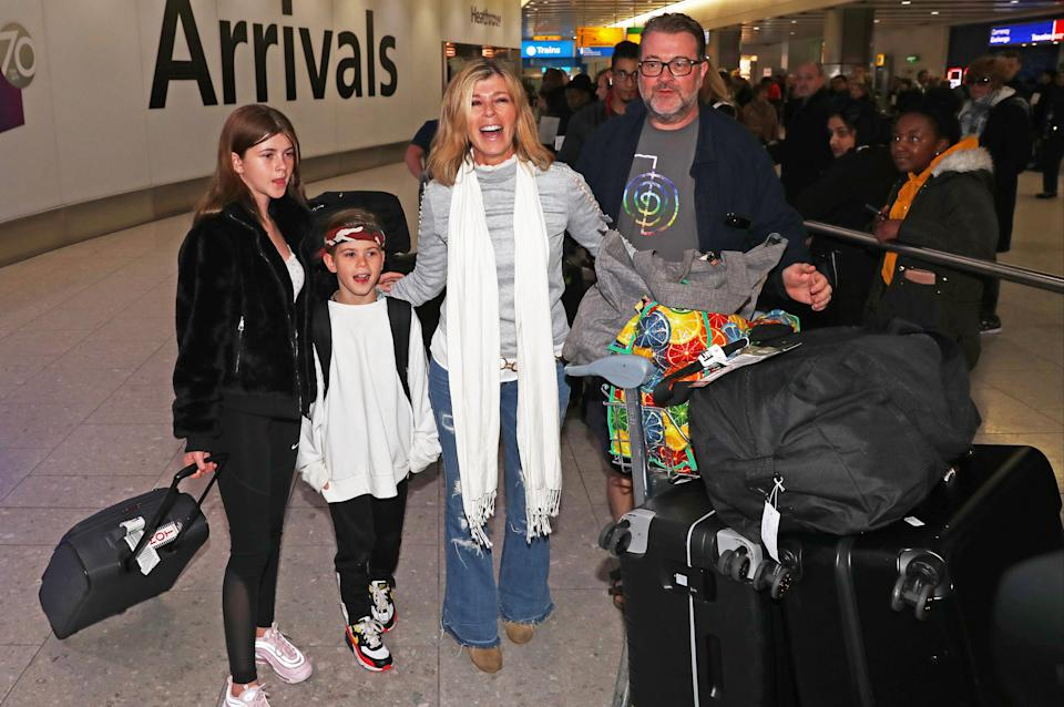 Kate Garraway with husband Derek Draper and their two children at Heathrow airport after she appeared on I'm A Celebrity ... Get Me Out Of Here! in 2019PA