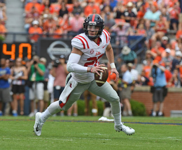 FILE - In this Oct. 7, 2017, file photo, Mississippi quarterback Shea Patterson (20) scrambles with the ball during the first half of an NCAA college football game against Auburn, in Auburn, Ala. Jim Harbaugh will lead Michigan through one more spring practice Tuesday, likely not knowing if Shea Patterson will be able to do more than practice in 2018. Two days later, most of the Wolverines are traveling to Paris to see some sights. By the time the Wolverines return from the trip, they hope to know if the NCAA will give Patterson a waiver to play instead of sitting out the season after transferring from Ole Miss. (AP Photo/Thomas Graning, File)