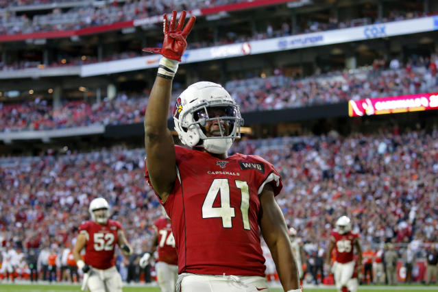 FILE - In this Dec. 15, 2019, file photo, Arizona Cardinals running back Kenyan Drake (41) motions after his fourth touchdown of the game during the second half of an NFL football game against the Cleveland Browns in Glendale, Ariz. Drake's agency said Saturday, March 21, 2020, that he will sign his one-year, $8.5 million tender to stay with the Cardinals. The Cardinals placed the transition tag on Drake earlier this week. (AP Photo/Ross D. Franklin, File)