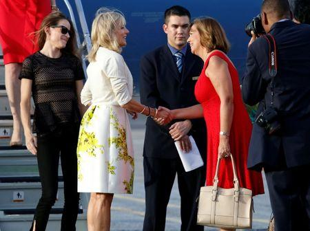 Jill Biden (2nd L), wife of U.S. Vice President Joe Biden and Josefina Vidal, director of U.S. affairs at the Cuban foreign ministry, shake hands upon Biden's arrival at Jose Marti airport in Havana, Cuba October 6, 2016. REUTERS/Stringer