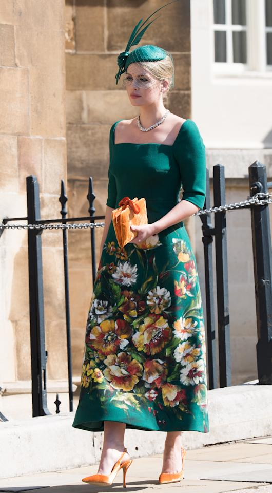 <p>For her cousin Harry's royal wedding, Spencer tasked fashion friends Stefano Gabbana and Domenico Dolce to create her a custom, hand-painted gown. She wore the green dress with a bespoke Philip Treacy hat and Bulgari jewels. (Photo: Getty Images) </p>