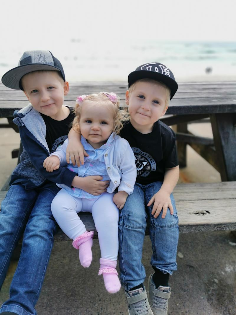 Ashana Simpson (centre) with her two big brothers. The baby has been diagnosed with two rare diseases. Source: Juanita Simpson