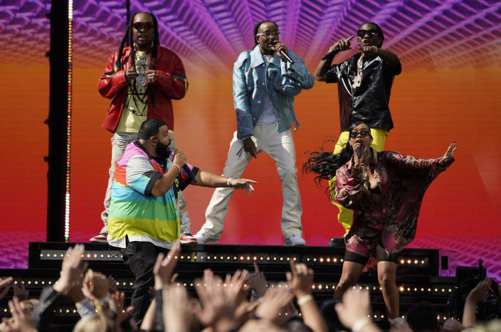 DJ Khaled, front left, and H.E.R., front right, perform with Takeoff, from background left, Quavo and Offset, of Migos, at the Billboard Music Awards on Sunday, May 23, 2021, at the Microsoft Theater in Los Angeles. (AP Photo/Chris Pizzello)
