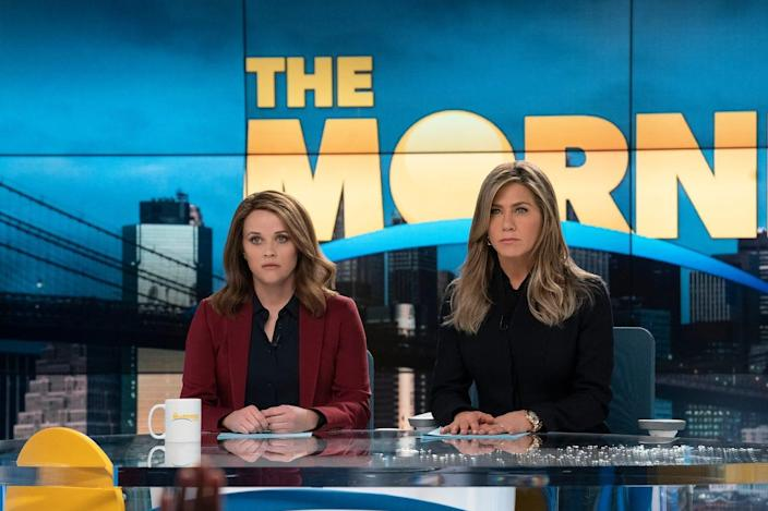 """Reese Witherspoon, left, and Jennifer Aniston in """"The Morning Show"""" on Apple TV+."""