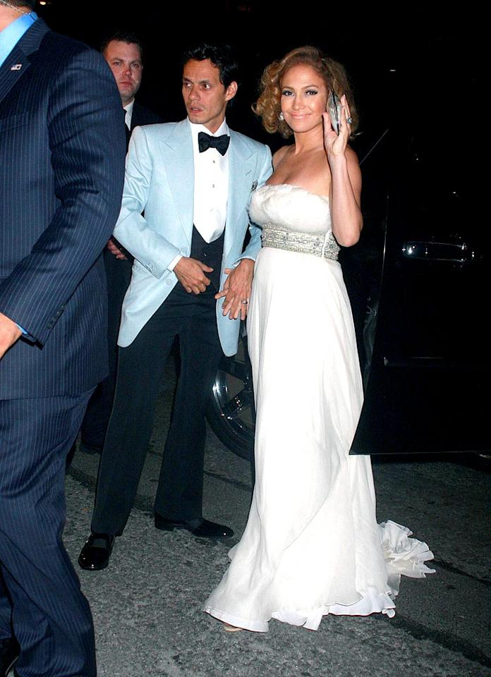 """Just hours after finishing a triathlon in Malibu, Jennifer Lopez threw husband Marc Anthony a star-studded 40th birthday bash at the Bowery Hotel in New York City. Jennifer looked stunning in a white Marchesa gown, while Marc clashed in a sky blue tuxedo jacket. Dara Kushner/<a href=""""http://www.infdaily.com"""" target=""""new"""">INFDaily.com</a> - September 14, 2008"""