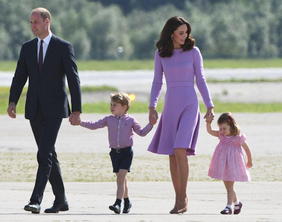 <p>The Duke and Duchess held hands with their young children, Prince George and Princess Charlotte, during a royal tour of Germany. The young family is color coordinated in bright hues as they board an aircraft in Hamburg. </p>