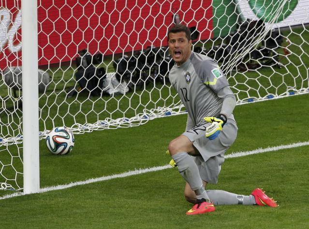 Brazil's goalkeeper Julio Cesar reacts after conceding a goal to Germany's Toni Kroos (unseen) during their 2014 World Cup semi-finals at the Mineirao stadium in Belo Horizonte July 8, 2014. REUTERS/David Gray (BRAZIL - Tags: SOCCER SPORT WORLD CUP)