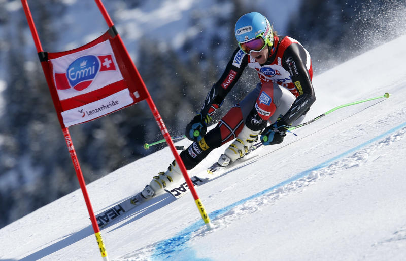 Ted Ligety of the United States skies down to the slope of the men's Alpine ski World Cup giant slalom first run at the World Cup final in Lenzerheide, Switzerland, Saturday, March 16, 2013. (AP Photo/Alessandro Trovati)