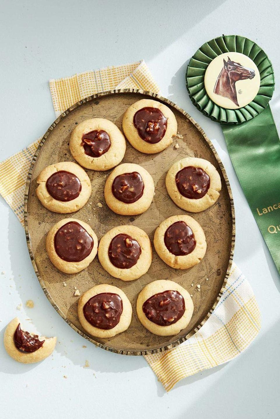 """<p>These easy homemade caramel cookies have a secret ingredient: A few tablespoons of bourbon adds a hint of spice and depth of flavor.</p><p><em><a href=""""https://www.countryliving.com/food-drinks/a32042556/caramel-chocolate-walnut-thumbprint-cookies/"""" rel=""""nofollow noopener"""" target=""""_blank"""" data-ylk=""""slk:Get the recipe from Country Living »"""" class=""""link rapid-noclick-resp"""">Get the recipe from Country Living »</a></em></p>"""