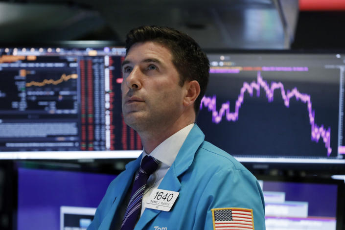 Trader Thomas McArdle works on the floor of the New York Stock Exchange, Wednesday, Aug. 14, 2019. The Dow Jones Industrial Average sank 800 points after the bond market flashed a warning sign about a possible recession for the first time since 2007. (AP Photo/Richard Drew)