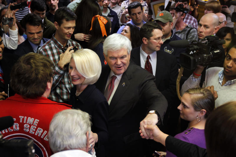 Republican presidential candidate former, House Speaker Newt Gingrich, seen with his wife Callista at center, campaigns at a Chick-Fil-A in Anderson, S.C., Saturday, Jan. 21, 2012, on South Carolina's Republican primary election day.  (AP Photo/Matt Rourke)