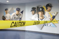 Caution tape closes off parts of Tropicana Field, home of the Tampa Bay Rays, during practice Sunday July 5, 2020, in St. Petersburg, Fla. (AP Photo/Mike Carlson)