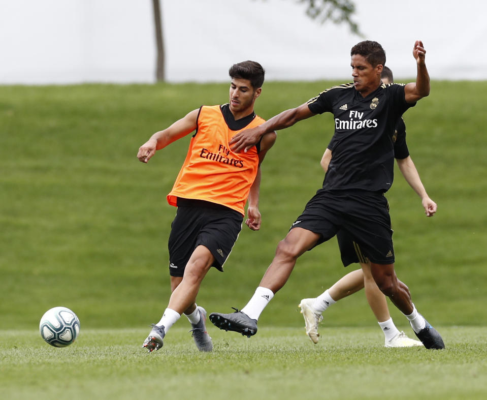 MONTREAL, QC - JULY 14: Marco Asensio (R) Raphael Varane of Real Madrid players performs continuous race exercises in their new preseason training session on July 14, 2019 in Montreal, Canada. (Photo by Helios de la Rubia/Real Madrid via Getty Images)