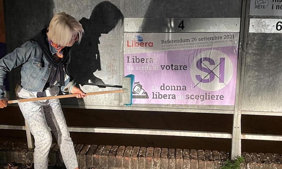 Doctor Francesca Nicolini puts up a pro-choice poster ahead of San Marino's referendum on abortion.