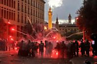 Lebanese security forces clash with protesters near the parliament in central Beirut
