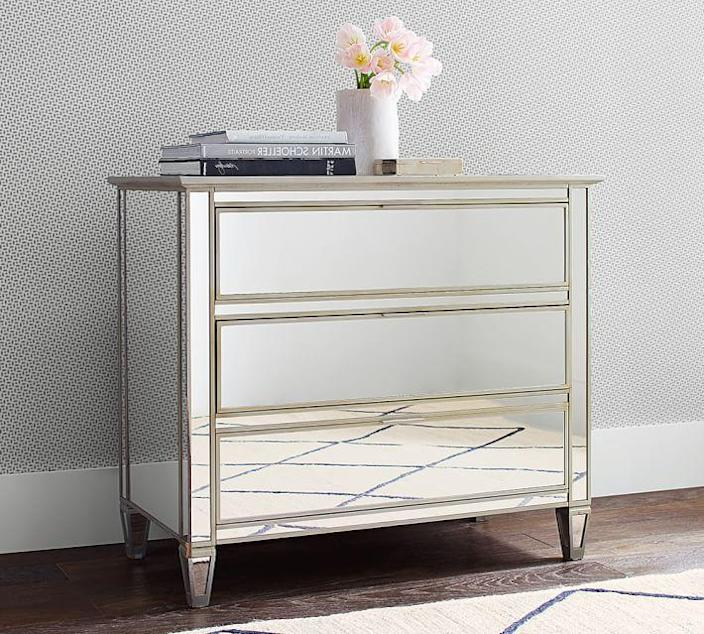 """Though a completely mirrored chest of drawers feels ultra-contemporary, the seriously symmetrical design recalls the glamour of early-19th-century Empire furniture. The champagne-toned giltwood trim brings this piece into the modern era. $999, Pottery Barn. <a href=""""https://www.potterybarn.com/products/park-mirrored-pull-dresser/?"""" rel=""""nofollow noopener"""" target=""""_blank"""" data-ylk=""""slk:Get it now!"""" class=""""link rapid-noclick-resp"""">Get it now!</a>"""