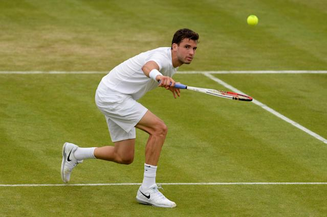 LONDON, ENGLAND - JUNE 27: Grigor Dimitrov of Bulgaria plays a backhand during his Gentlemen's Singles second round match against Grega Zemlja of Slovenia on day four of the Wimbledon Lawn Tennis Championships at the All England Lawn Tennis and Croquet Club on June 27, 2013 in London, England. (Photo by Mike Hewitt/Getty Images)