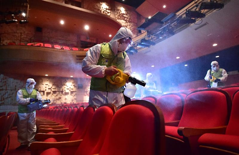 South Korean health workers fumigate a theatre at the Sejong Culture Center in Seoul, on June 16, 2015 (AFP Photo/Jung Yeon-Je)
