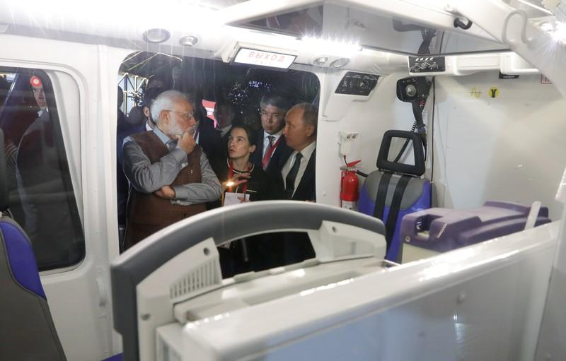 Russian President Putin and Indian Prime Minister Modi inspect a helicopter on the sidelines of the Eastern Economic Forum in Vladivostok