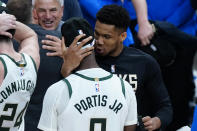 Milwaukee Bucks forward Giannis Antetokounmpo embraces Bobby Portis (9) after the Bucks defeated the Atlanta Hawks in Game 6 of the Eastern Conference finals in the NBA basketball playoffs, advancing to the NBA Finals, Saturday, July 3, 2021, in Atlanta. (AP Photo/John Bazemore)