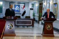 Iraqi Foreign Minister Fouad Hussein speaks with Iraqi Culture Minister Hassan Nadhim during a news conference at the Ministry of Foreign Affairs in Baghdad