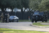 Law enforcement officials work on the scene of an officer-involved shooting at an apartment complex on Tuesday, Oct. 20, 2020, in Houston. Two Houston officers were shot before a SWAT team was dispatched to the scene, where the suspected shooter was arrested, authorities said. (Godofredo A. Vásquez / Houston Chronicle via AP)