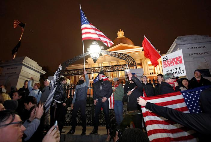 <p>Protesters stand on the state house steps during a march in opposition to the election of Republican Donald Trump as President of the United States in Boston, Massachusetts, U.S. November 9, 2016. (REUTERS/Mary Schwalm) </p>