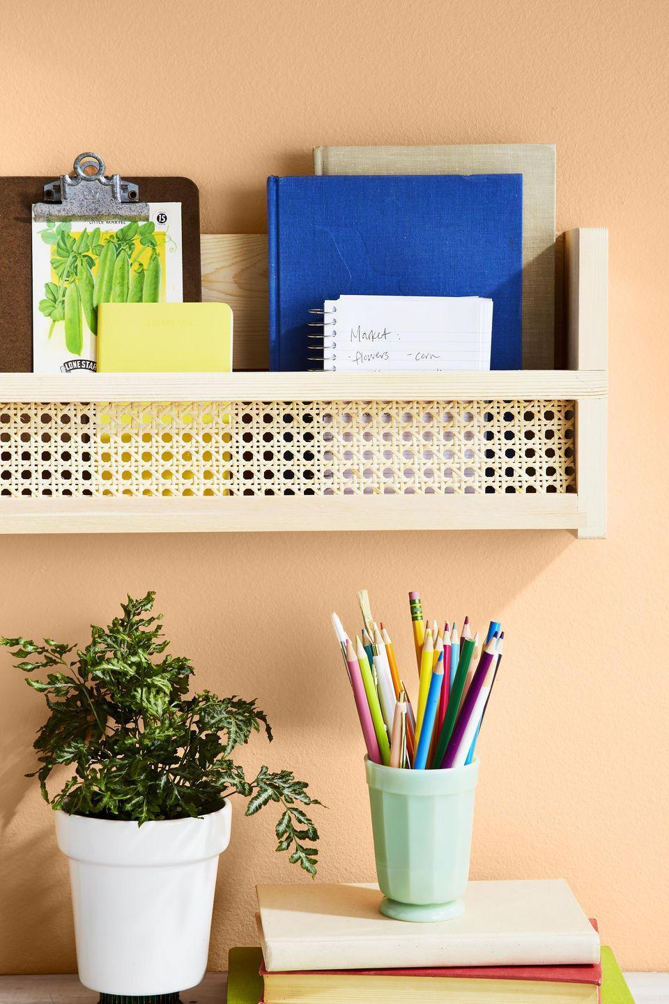 """<p>That blank wall in your home office is about to get a lot cuter with the addition of a bookshelf that been adorned with cane webbing.</p><p><strong>To make:</strong> Trim a piece of caning just larger than the opening on<br>the shelf (<a href=""""https://www.amazon.com/brightmaison-Wooden-Shelves-Molding-Material/dp/B072W8XNL1/ref=sr_1_8"""" rel=""""nofollow noopener"""" target=""""_blank"""" data-ylk=""""slk:Brightmaison's floating bookshelf; amazon.com"""" class=""""link rapid-noclick-resp"""">Brightmaison's floating bookshelf;<em> amazon.com</em></a>). Use a foam brush to spread glue (we used Aleene's Original Tacky Glue) to the back of the shelf opening. Attach caning, holding it in place<br>with binder clips while it dries. Once dry, remove clips and hang shelf.<br></p>"""