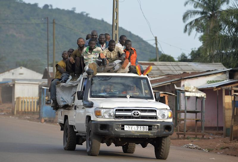 Members of the ex-Seleka rebels drive near a convoy of Chadian soldiers (Unseen) leaving Bangui escorted by the African-led International Support Mission to the Central African Republic (MISCA) on April 4, 2014